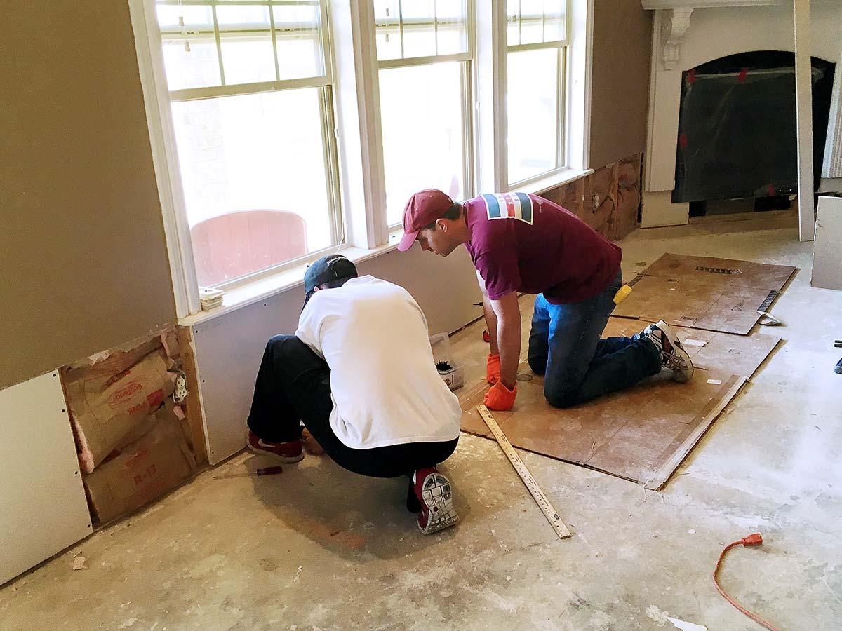 Damaged in flood, coworkers pitch in to help repair Garver engineer's home