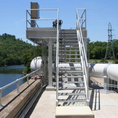 Siphon provides minimum flow through dam, benefits fish habitat